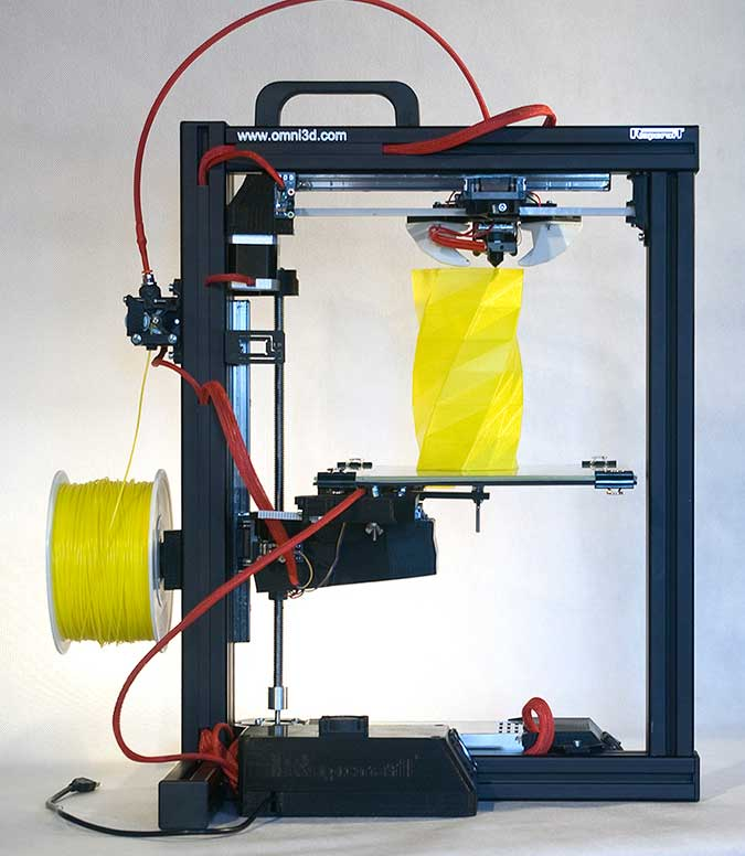 The Omni3D RapCraft 1.3 3D Printer using coloured ABS plastic