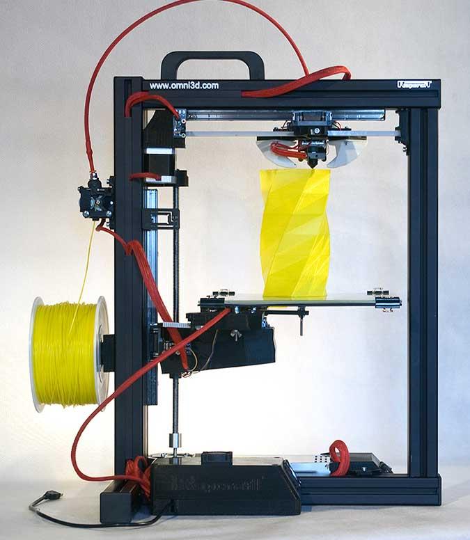 The Omni3D RapCraft 1.3 3D Printer using coloured ABS plastic