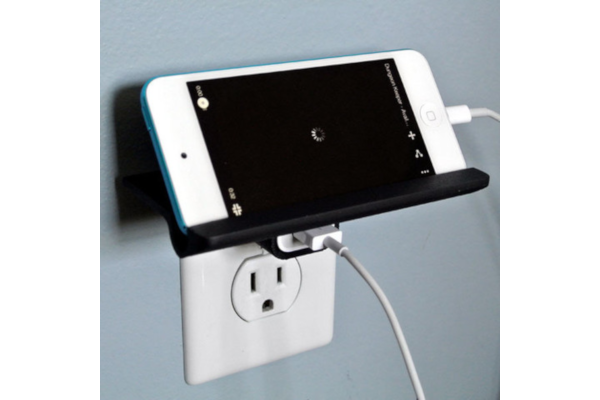 Wall outlet shelf